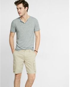 A warm-weather essential in soft, easy-wear cotton. Cargo pockets and a solid hue turn up the utility and versatility on these shorts that beg to be worn with a polo, tee or lightweight sweater. Styling is effortless with this pair. Easy Wear, Warm Weather, Men Casual, Shorts, Tees, Classic, Fitness, Cotton, Mens Tops