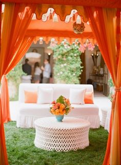 Orange and white decorated outdoor event, neat way to incorporate orange...image with all the purple accents.