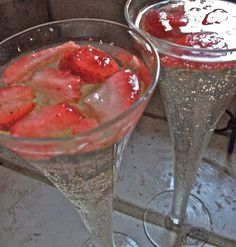 Strawberry Champagne Punch  1 64 oz bottle White Grape Juice 2 liter 7up 1 bottle Extra Dry champagne 16 oz Club Soda 1/2 - 1 cup sugar Frozen strawberries
