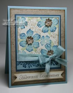 """Like the arrangement of the flowers stamped on the top layer and also the bow and the sentiment in the """"ribbon like"""" paper layer. LW Designs: Saying Goodbye to Vintage Vogue"""