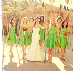 YES! Green bridesmaid dresses, orange flowers, mermaid style wedding dress. Perfection. i would love to know where these are from!!