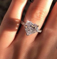 Heart shaped engagement ring. I like the simplicity but wouldn't necessarily want this cut.