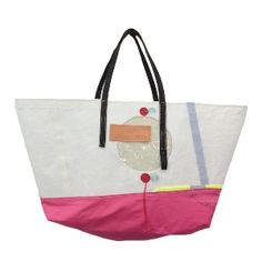 Rocke & Nutter White & Pink Beach Shopper Bag: These bags by Rocke & Nutter all vary slightly as they are made from reclaimed sails. The handles and highlight detail are made from reclaimed horse reins and high vis jackets. It has an internal pocket and is lined with waterproof sail fabric.