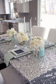 Elegant New Year's Eve party decoration idea that you can do to impress your guests. Use sequin table cloth & fancy looking but not expensive table top decorations Glamour Party, Sequin Tablecloth, Sequin Fabric, Wedding Tablecloths, New Years Eve Weddings, Hollywood Party, Hollywood Glamour, Nye Party, Glamour