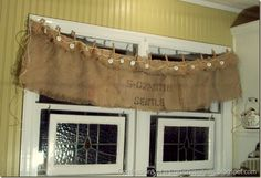 no sew burlap kitchen valances | In a nutshell, I had slapped some burlap pieces up on a rope with ...