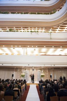 Wedding in atrium. For more booking info: http://salonrentals.torontopubliclibrary.ca/