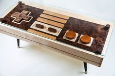 Nintendo controller coffee table. My husband would love this for his game room.