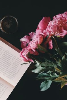 Pink Flower Bouquet Beside Opened Book