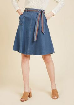 <p>Brace yourself, because this denim skirt is about to ignite a flurry of fashion fantasies in you! The sleek front seams, essential side pockets, and rainbow-striped belt of this ModCloth-exclusive A-line make it irresistible to envision a bevvy of your best looks to come. What a wardrobe necessity!</p>