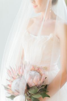 king protea bouquet Photography: Carmen And Ingo Photography - carmenandingo.com  Read More: http://www.stylemepretty.com/2014/05/23/romantic-hawaiian-bridal-inspiration/