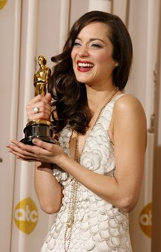 Marion Cotillard - Marion Cotillard's dreamy, side-parted look is the polished version of French insouciance.
