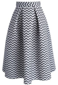 Need a fab black-and-white look for a slight daytime slay? Look no further than this Airy midi skirt. Tuck a bright blouse into it and slip into a pair of strappy sandals.  - Zigzag pattern - Back zip closure - Not lined - 100% polyester - Machine washable  Size(cm)Length  Waist XS         69     62 S           69   ...
