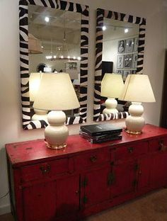 eliware: eclectic mix  red asian cabinet, white gourd lamps and zebra mirrors