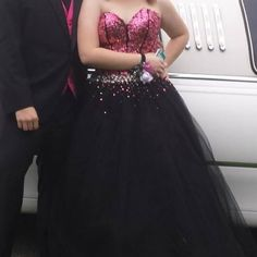 Black and pink prom dress Pink and black Corset back ball gown. Worn once! Offers welcome! Size 8 goes up to about a 12 down to probably a 6 Dresses Prom