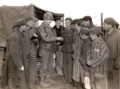 A US Army soldier gives oranges to starving survivors of the Wöbbelin concentration camp:  Wöbbelin concentration camp, a subcamp of Neuengamme concentration camp, was established in February 1945 to hold prisoners evacuated from other camps in order to prevent their liberation by the approaching Allied forces. At its height the camp housed approximately 5,000 inmates. Wöbbelin was liberated by American troops on May 2, 1945, who found around 1,000 corpses strewn throughout the camp.