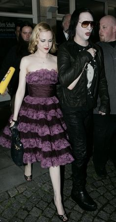I love how I'm looking up tea party dresses on pinterest and Marilyn Manson shows up! Ha I love it! Too bad that purple dress is so ugly!