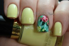 Summer Roses - The yellow is Revlon Sunshine Sparkle and the blue is OPI What's With The Cattitude. The roses and leaves are all done with acrylic paint. - Nail Art