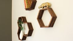 Popsicle sticks have never looked so chic! You'd guess these are @westelm. Make #DIY honeycomb #shelves for less than $10! Click through for the free template.