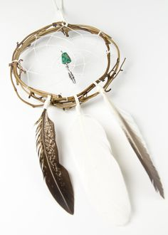 dream catcher craft, the gem must be off centered out of the dream catching center.