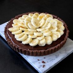 unbelievably decadent nutella banana tart which has a chocolate shortbread crust, filled with nutella, caramelized bananas, a bittersweet chocolate ganache, and some ripe bananas on top