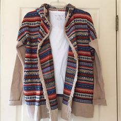 Beautiful Hanna Andersson Sweater Perfect year-round weight but has that fall - winter vibe I love. 100% cotton. Pockets. Open sweater - jacket style with fringe on front. Hooded. Alpine - Scandinavian print that HA is so well known for! Hanna Andersson Sweaters
