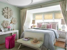 This pretty and practical bedroom nook is packed with gorgeous elements of cottage style thanks to muted pastels and flirty, feminine accents.