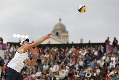 Beach Volleyball: Men's Quarterfinals - Beach Volleyball Slideshows | Brazil's Alison serves against Poland's Mariusz Prudel and Grzegorz Fijalek during their men's quarterfinals beach volleyball match  (Photo: MARCELO DEL POZO / Reuters) #NBCOlympics