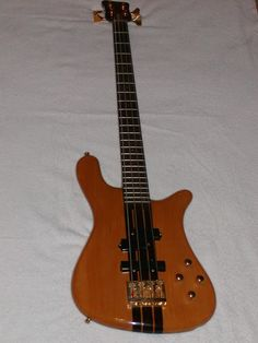 "OWNed = 1986 German Warwick Streamer Stage I neck-thru ... 5-ply Maple neck, Western Cherry Body, High Gloss Natural Finish, Bolivian Rosewood fret board w/ mother-of-pearl inlays, EMG 9v Active ""P"" + ""J"" Pickups ... AWESOME BASS !  http://www.warwickbass.com/en/Warwick--Instruments--Made-in-Germany--Warwick-Series--Streamer--Streamer-Stage-I--4-string--Pictures.html"