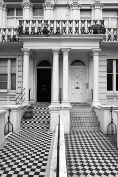 London townhouses. Love those black and white tiled pathways.