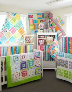 really like most of these quilts, with the white and the colors, especially the one in the lower right corner