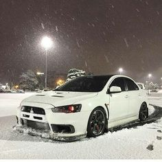 wicked white evo x red eyes slammed and snow looking sexy as fuck