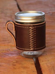 "I like the idea, I have an assortment of old leather that I could use for this slip on, glass protector ""cozy."" I like the handle, nice touch. Mason Jars are ""in"" too. Could use this on the go instead of those K-cups that cause health problems anyways."