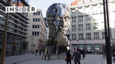 Artist David Černý created a 45-ton rotating sculpture of Franz Kafka's head, which faces City Hall in Prague. Wassily Kandinsky, Prague City, Street Art, Street View, Before We Go, Colossal Art, Kinetic Art, Statue, City Streets