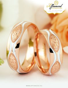 Handcrafted, rose gold wedding rings decorated with white ceramic inlay and handmade engraving.