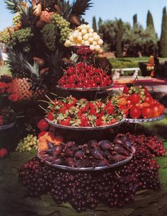 Stacked fruit platters.