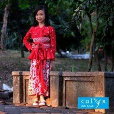 "Calyx ""Wanoja"" jumputan kebaya (tye dye), paired with ""Hanum"" batik maxi skirt (obi belt included)."