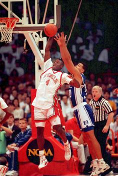 UNLV forward Larry Johnson escapes the reach of Duke's Alaa Abdelnaby while en route to the basket. The Running Rebels kept the game out of reach for the Blue Devils as well, winning the NCAA title with a record-setting victory in Denver on April I Love Basketball, Basketball Pictures, Basketball Legends, College Basketball, Basketball Players, Dodgers, Larry Johnson, College Hoops, Netball