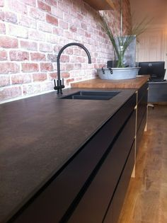 This #Porcelain worktop looks like pitted metal! A cool design feature for our Pure #kitchen range