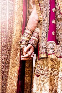 Aww:) It's a wedding picture of the bride and groom for those who can't tell:) This is beautiful. I love the cultural significance of a white dress, but this has it's own regality.