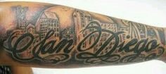 Russ from El Mirage posted: I want a tattoo of the city of san diego skyline. i have posted a pic of a example of what i would like. would like some quotes and would also like it to be one of a kind. so this is just a example and you can make the lettering the same or cooler. but a capital s and d lol. would still want the sunset and palm trees with the birds and could be in a defferant spot. same with the coronado bridge. would also like to have the chargers bolt and padres  symbol  in there...