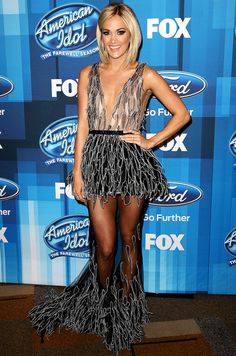 Carrie Underwood in a sheer black plunging Yanina Couture dress