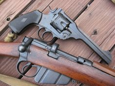 Webley Revolver and Lee Enfield Rifle,British WWII Guns.
