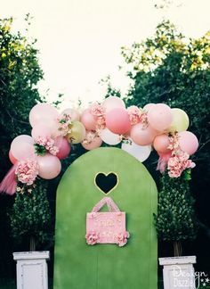 Fairy gate and sign are made out of cardboard! This fairy party cost less than $100 to create. There are lots of CREATIVE and AFFORDABLE DIY projects that can be easily recreated to make your own fairy party on a budget!! Design Dazzle #partyonadime #fairyparty #budgetparty