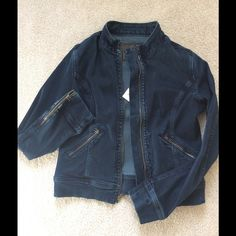 Orig. $255 AG moto cut jean jacket AMAZING Adriano Goldschmeid motorcycle cut Jean jacket NWT. Beautifully cut and sewn, it is rayon, cotton, polyester and spandex. It hugs and stretches in all the right ways. Great zipper detail on cuffs. Dressy denim! AG Adriano Goldschmied Jackets & Coats Jean Jackets