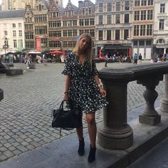 It's time for a citytrip! Babe Esmee van Es wearing our cute ruffle dress in Antwerp! Get yours now at Marcez.