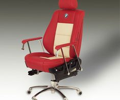 Spanish artist Elías Cuadrado González uses Yamaha and Peugeot motors to create the bases for tables, lamps, sculptures, and clocks. He'll also convert driver and passenger seats into comfortable office chairs, like the red and beige leather armchair from a BMW series 5 E-34 pictured here.