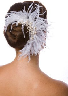 Love this style and the way the feathers fall naturally around the chignon.  Very stylish.