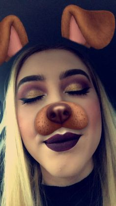Dark plum and gold shadow look using a mixture of the Huda Beauty rose gold palette, Anastasia modern Renaissance and morphe 35f. Lipstick is Kat Von d liquid lipstick in exorcism. Of course I had to include the dog filter 🤷🏼‍♀️