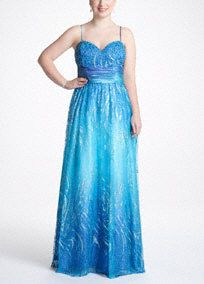 This traditional ball gown gets a modern update for a prom dress that is fashionable and fabulous!   Davids...Beaded sweetheart bodice features ruched ombre waistband to slim and flatter.  Charmeuse ombre fabric features vibrant glitter tulle overlay to add fashion-forward and fun twist.  Fully lined. Back zip. Imported polyester. Spot clean only.  Also available in missy sizes as Style 17361D.