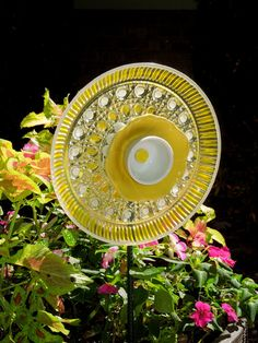 glass yard art made from recycled dishes | YARD art and GARDEN sculpture made with recycled glassware